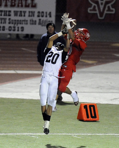 Arbor View defensive back Charles Louch (21) intercepts a pass intended for Palo Verde runni ...