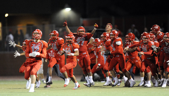 Arbor View players celebrate their 27-7 win over Palo Verde in Sunset Region semifinals on F ...