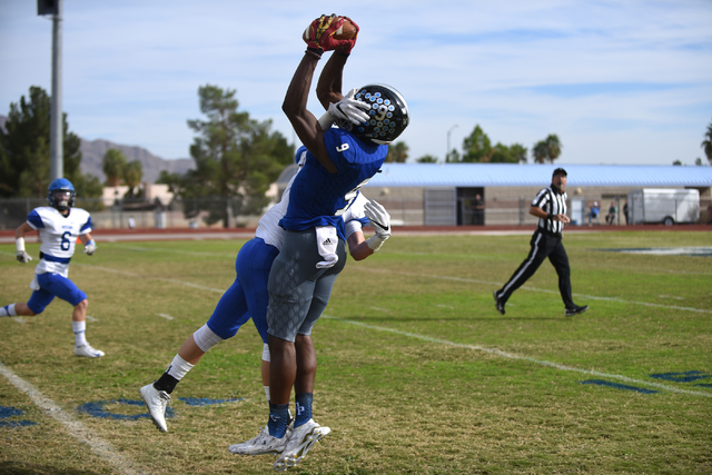 Desert Pines Randal Grimes (9) catches the ball for a first down against South Tahoe during ...