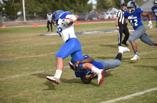 Desert Pines Andrew Gray (8) tackles South Tahoe's Andrew Herrera (36) during their 3A ...