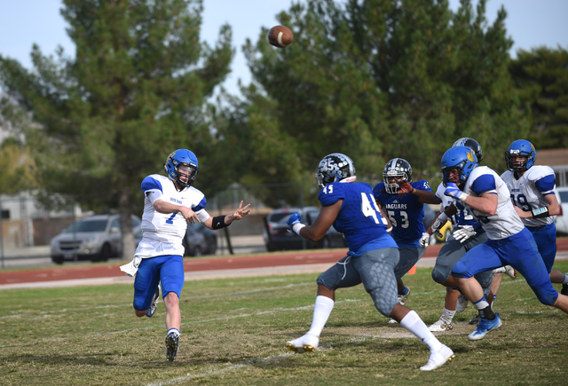 South Tahoe's Tommy Cefalu (7) throws the ball against Desert Pines during their 3A st ...