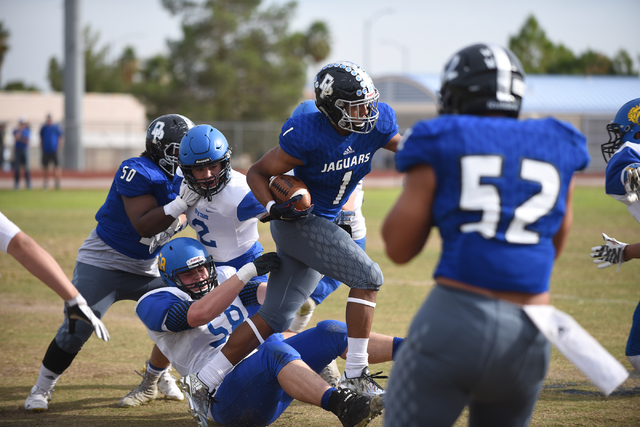Desert Pines Tony Fields (1) runs the ball against South Tahoe during their 3A state semifin ...