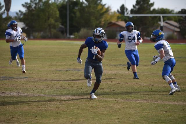 Desert Pines Isaiah Morris (7) runs the ball against South Tahoe during their 3A state semif ...