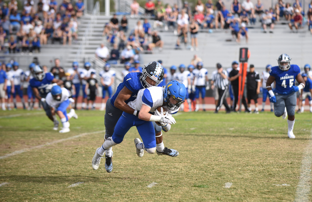 Desert Pines Tony Fields (1) tackles South Tahoe's Dylan Gooding (4) during their 3A s ...