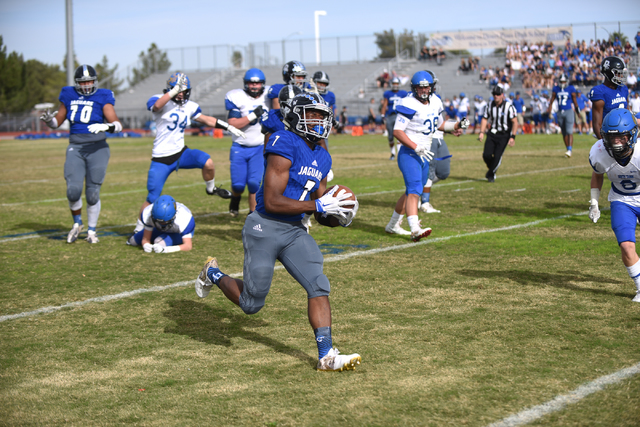 Desert Pines Isaiah Morris (7) runs the ball in for a touch down against South Tahoe during ...