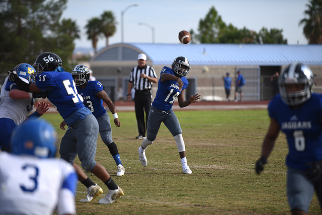 Desert Pines Tyler Williamson (19) throws the ball against South Tahoe during their 3A state ...