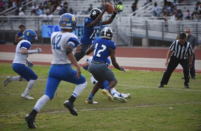 Desert Pines Tyler Williamson (19) dives in the end zone for a touch down against South Taho ...