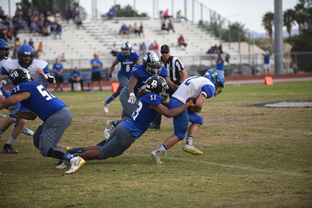 Desert Pines Lorenzo Brown (53) tackles South Tahoe's Jacob Costly (2) during their 3A ...