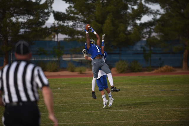 Desert Pines Antonio Wallace (3) attempts a catch against South Tahoe during their 3A state ...
