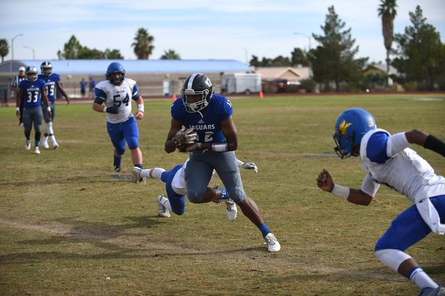 Desert Pines Jordan Simon (12) runs the ball against South Tahoe during their 3A state semif ...