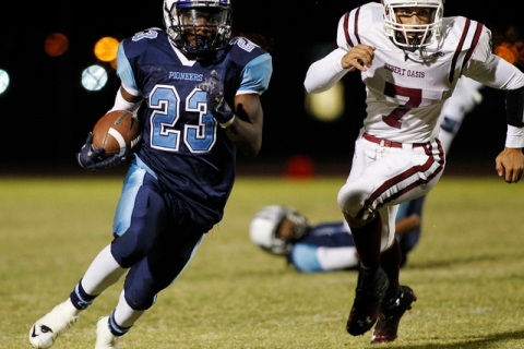 Junior running back Zaviontay Stevenson of Canyon Springs, shown carrying the ball against D ...
