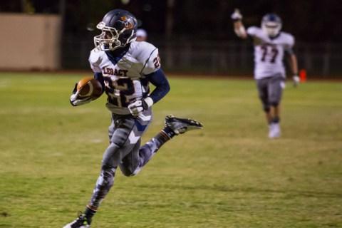 Legacy's DeMichael Walker scores a touchdown during the second quarter at Cimarron-Mem ...