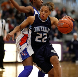 Centennial's Teirra Hicks drives by Bishop Gorman's Maddison Washington during t ...