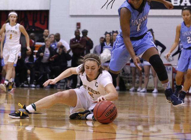 Bishop Manogue's Malia Holt (5) recovers a loose ball over Centennial's Pam Wilm ...