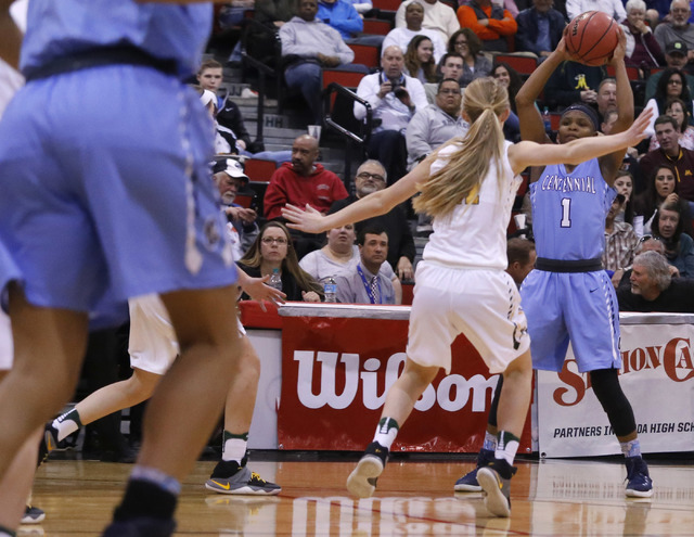 Centennial's Pam Wilmore (1) looks for a pass during the first half of a Class 4A girl ...