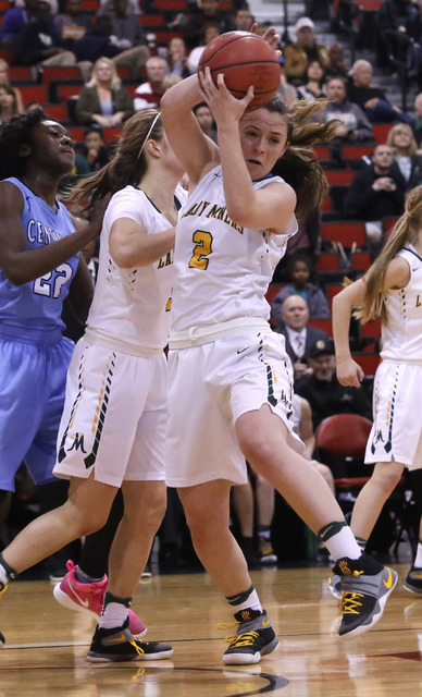 Bishop Manogue's Maddie Camacho (2) recovers a rebound during the first half of a Clas ...