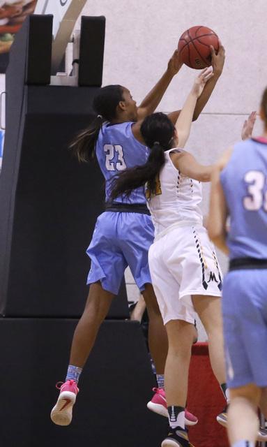 Centennial's Daejah Phillips (23) grabs a rebound during the second half of a Class 4A ...