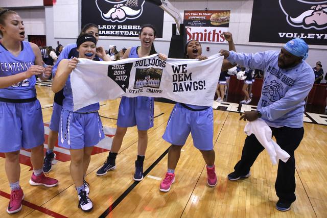 Centennial players celebrate after winning their third straight Class 4A girls state final c ...