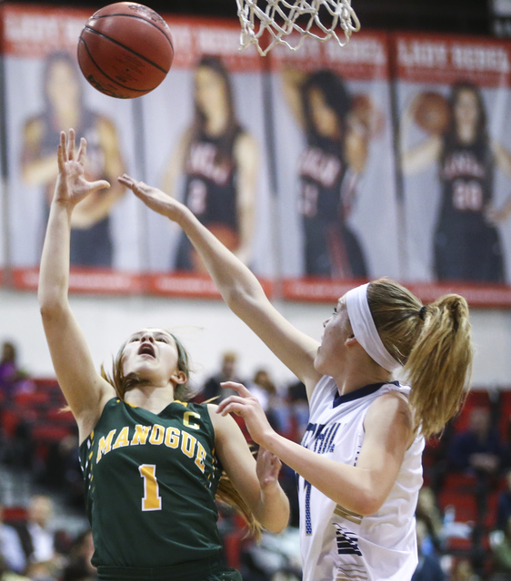 Bishop Manogue guard Katie Turner (1) shoots to score over Foothill's Kylie Vint (11) ...