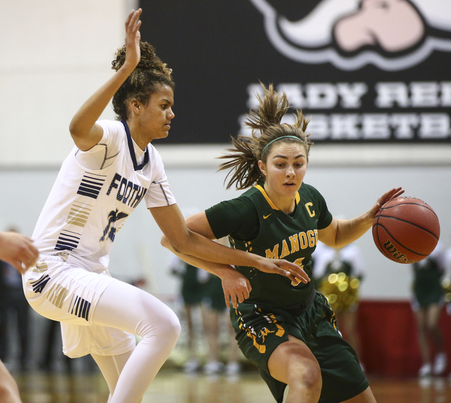 Bishop Manogue guard Malia Holt (5) drives against Foothill's Rae Burrell (12) during ...