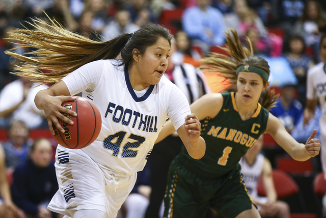 Foothill's Trinity Betoney (42) drives the ball against Bishop Manogue guard Katie Tur ...