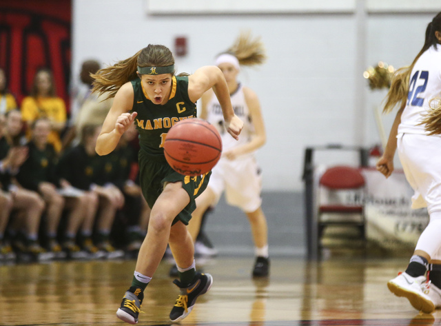 Bishop Manogue guard Katie Turner (1) drives the ball against Foothill during the Class 4A g ...