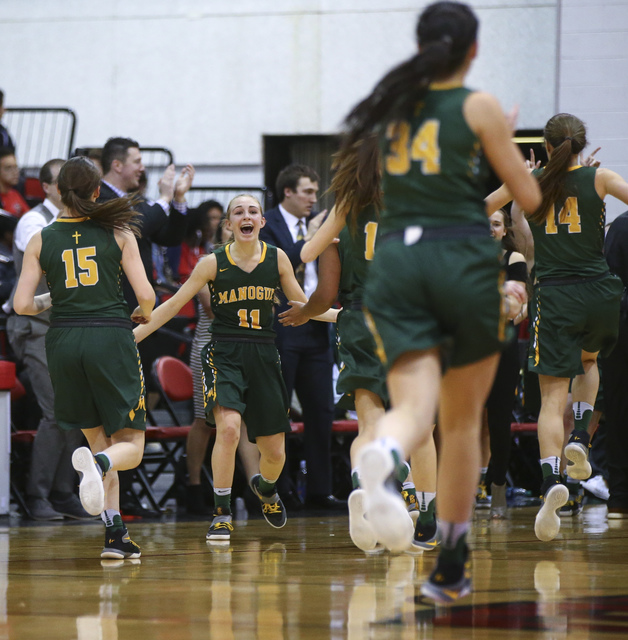 Bishop Manogue players react after defeating Foothill 74-37 in the Class 4A girls state bask ...