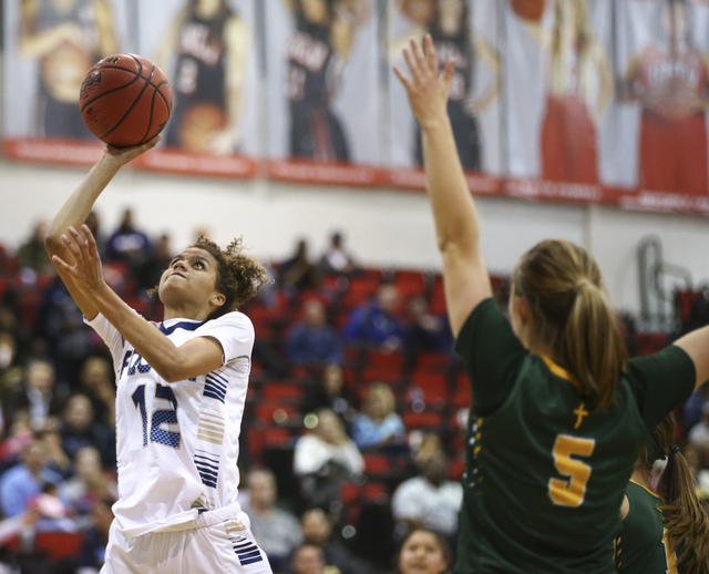 Foothill's Rae Burrell (12) shoots against Bishop Manogue during the Class 4A girls st ...