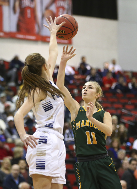 Bishop Manogue guard Kenna Holt (11) shoots over Foothill's Aqui Williams (2) during t ...
