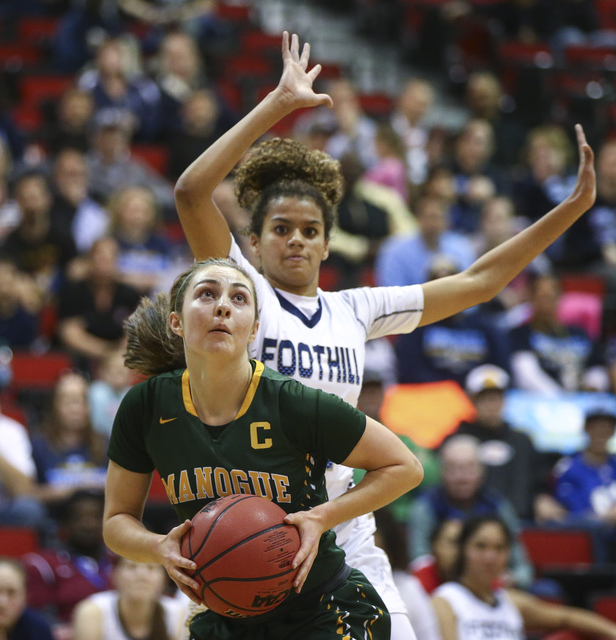 Bishop Manogue guard Malia Holt (5) drives to the basket against Foothill during the Class 4 ...