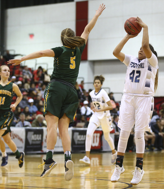 Foothill's Trinity Betoney (42) shoots over Bishop Manogue guard Malia Holt (5) during ...