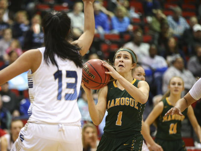 Bishop Manogue guard Katie Turner (1) shoots against Foothill during the Class 4A girls stat ...