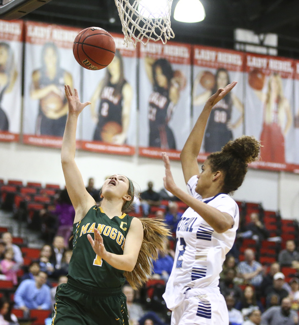 Bishop Manogue guard Katie Turner (1) goes to the basket over Foothill's Rae Burrell ( ...
