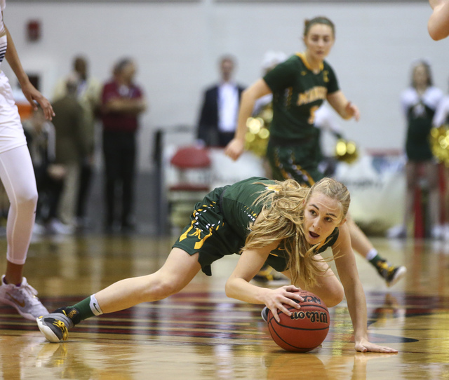 Bishop Manogue guard Kenna Holt (11) reaches out to keep control of the ball during the Clas ...