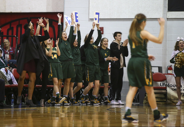 Bishop Manogue players cheer as they play Foothill during the Class 4A girls state basketbal ...