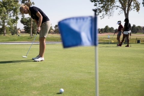Faith Lutheran's Sydney Smith, 16, hits a putt during a team practice at the Palm Vall ...