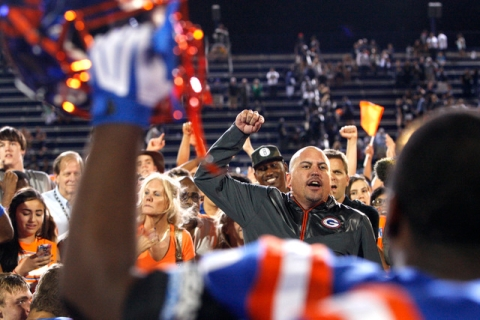 Bishop Gorman coach Tony Sanchez and his players celebrate defeating St. John Bosco, 34-31, ...