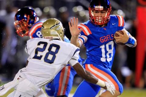 Bishop Gorman quarterback Tate Martell scrambles away from St. John Bosco defensive back Tra ...