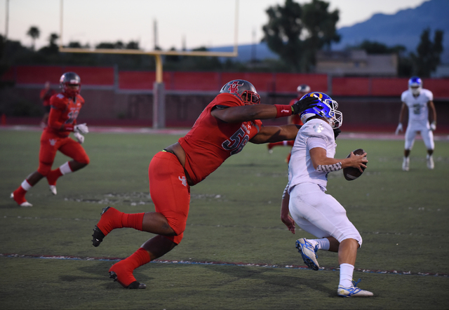 Arbor View's Greg Rogers (56) tackles an Orem player during their football game played ...