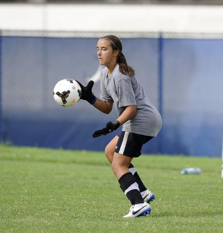 Green Valley girls soccer freshman goalkeeper Ryan Sabol makes a save during practice. (Josh ...