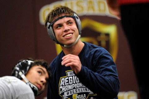 Faith Lutheran wrestler Owen Lawrie, left, smiles during a short break while grappling with ...