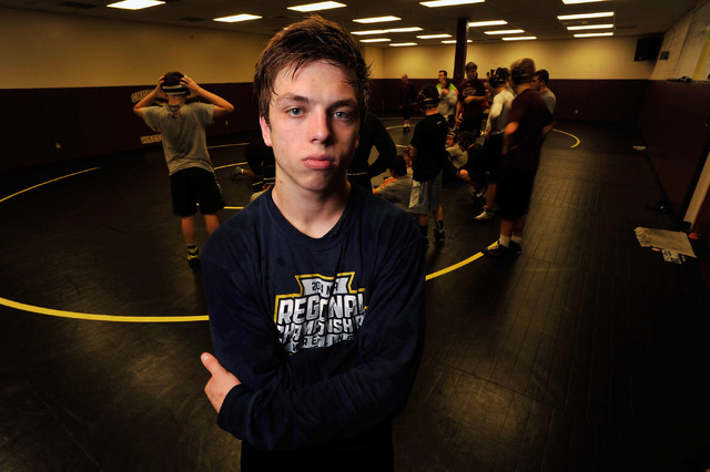 Faith Lutheran wrestler Owen Lawrie poses during a short break from training at Faith Luther ...