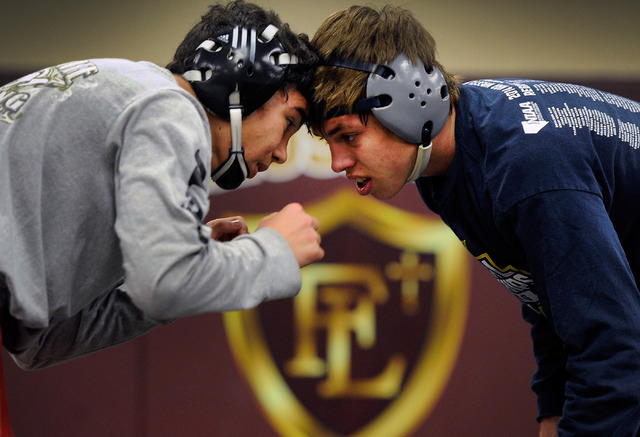 Faith Lutheran wrestler Owen Lawrie, right, goes head-to-head with teammate Hale Enos during ...