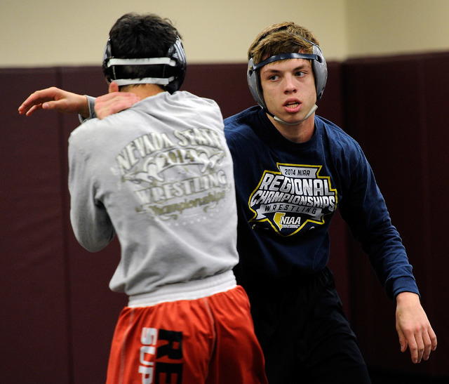 Faith Lutheran wrestler Owen Lawrie, right, grapples with teammate Hale Enos during practic. ...