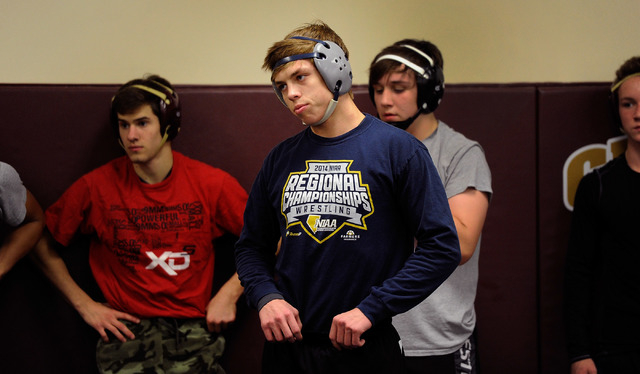 Faith Lutheran wrestler Owen Lawrie, center, looks on during practice. The senior is looking ...