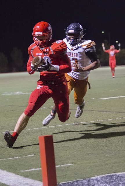 Arbor View's Andrew Wagner (42) scores a second quarter touchdown during the Sunset Re ...