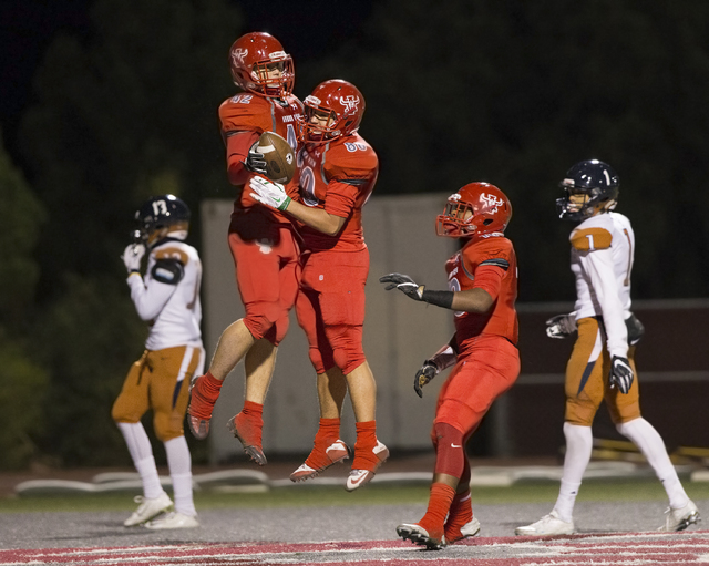 Arbor View's Andrew Wagner (42) celebrates with Robert Linero (80) after scoring a fir ...