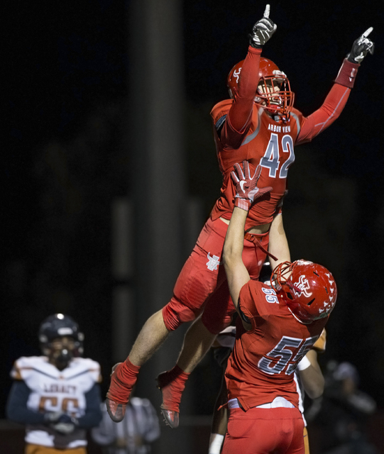 Arbor View's Andrew Wagner (42) celebrates with Cristian Taylor (55) after scoring a f ...