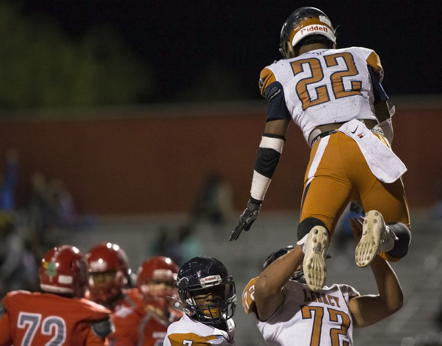 Legacy's Sam Turner (22) celebrates with Noah Jefferson (72) after scoring a touchdown ...