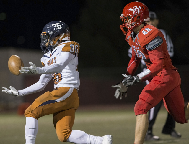 Legacy's Amorey Foster (36) attempts to pull in a pass with Arbor View's Andrew ...